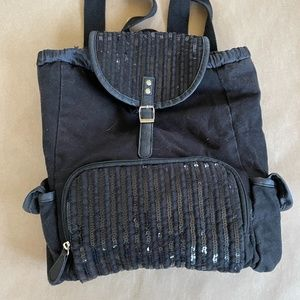 black purse backpack with sequins